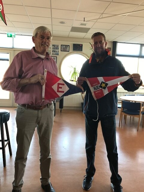 Evert exchanges burgees with the Commodore of the Haarlem Jacht Club in the Netherlands