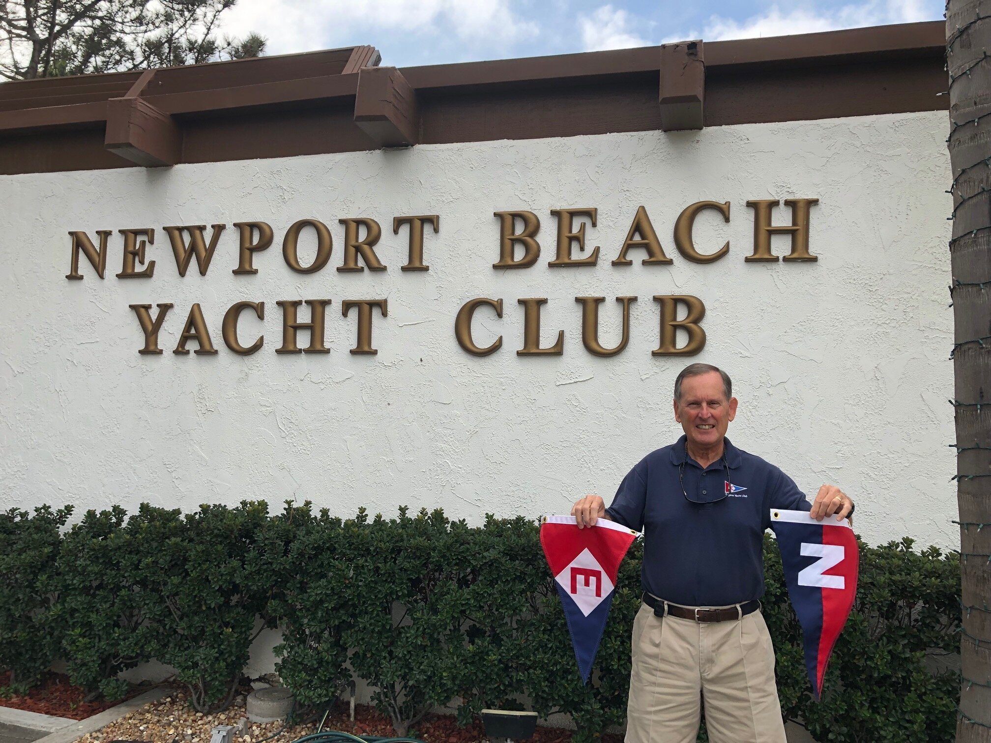 Gary exchanges burgees with the Newport Beach Yacht Club in California