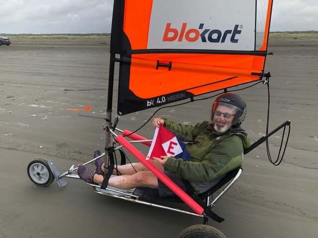 Chris lets the EYC colors fly while landsailing in Ocean Shores, Washington