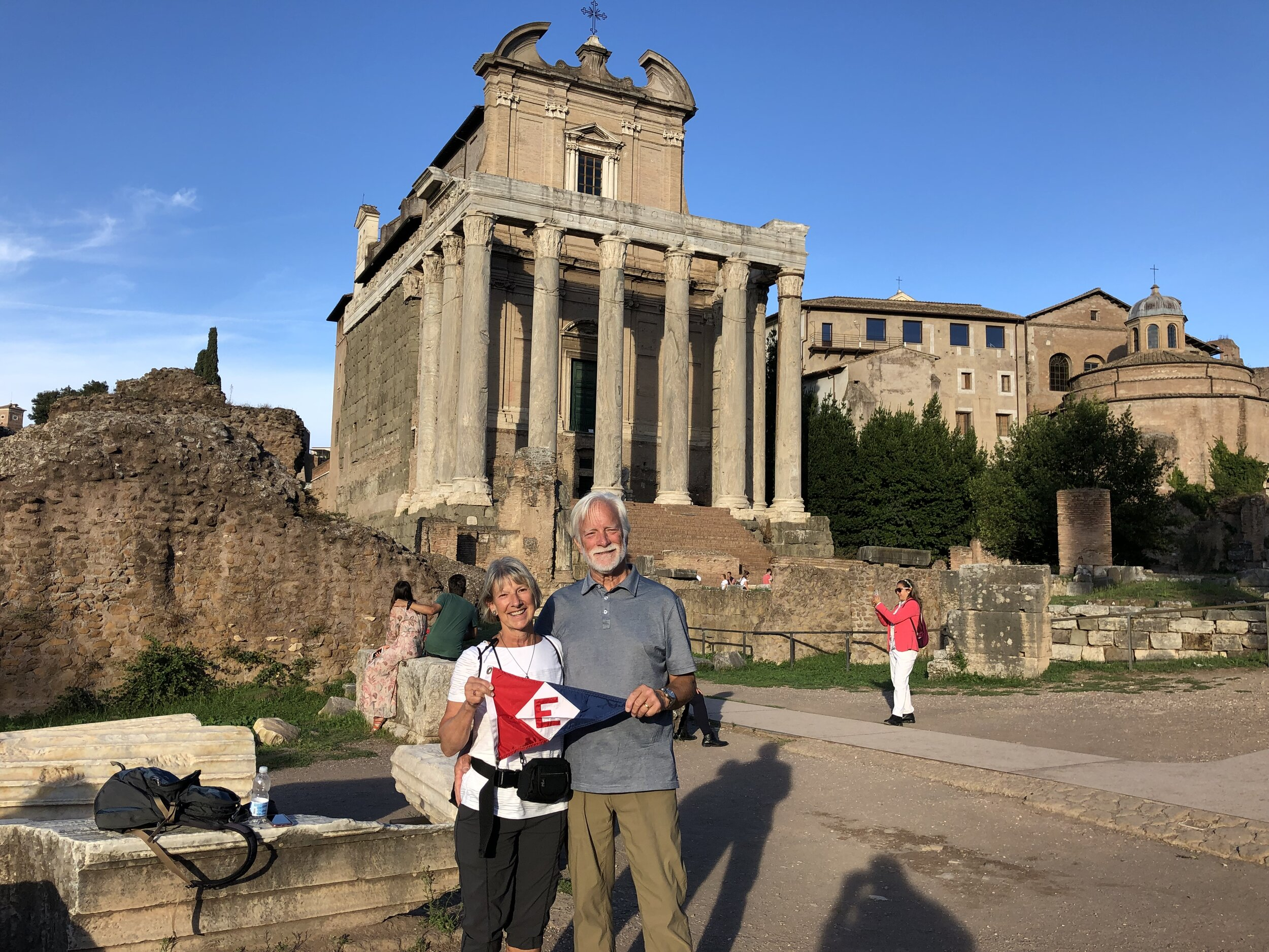 Chris & Ken hoist the colors in front of the Forum in Rome, Italy