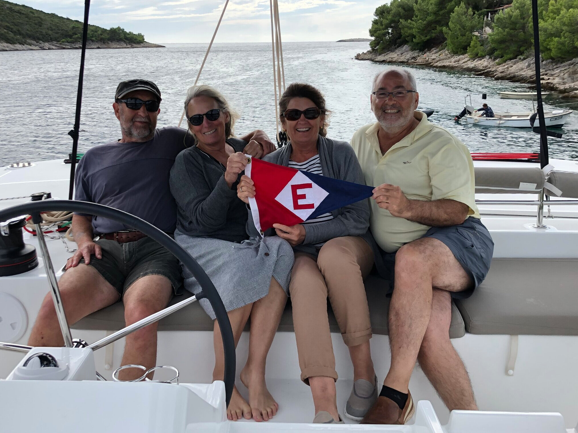 René and Lynne and Shelley and Nick show their EYC pride while cruising off the Dalmatian coast in Croatia
