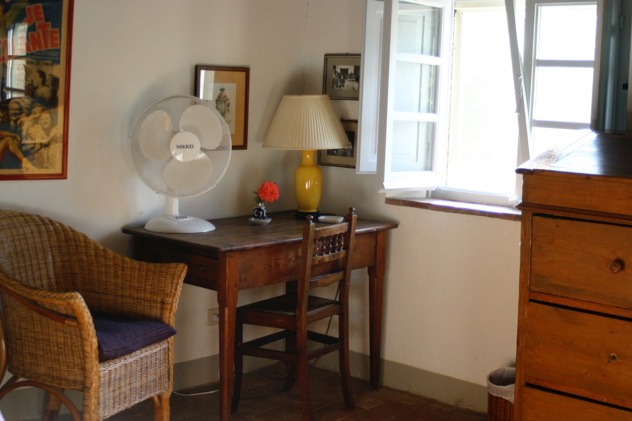 All bedrooms are equipped with fans, window screens, and a variety of antique dressers, armoires, and writing desks.