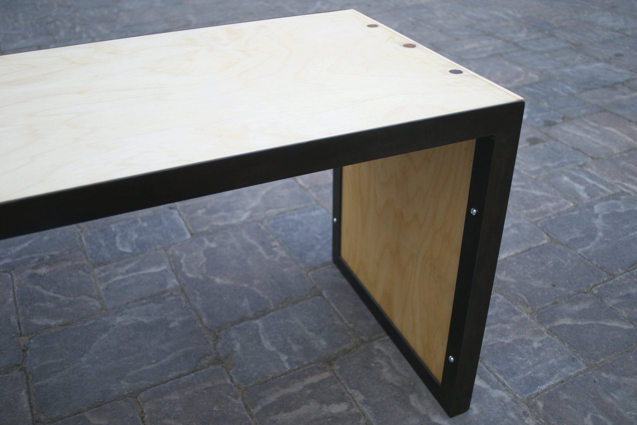 Bench   Steel frame, black-oxide finish.  Birch plywood panels, steel pins.