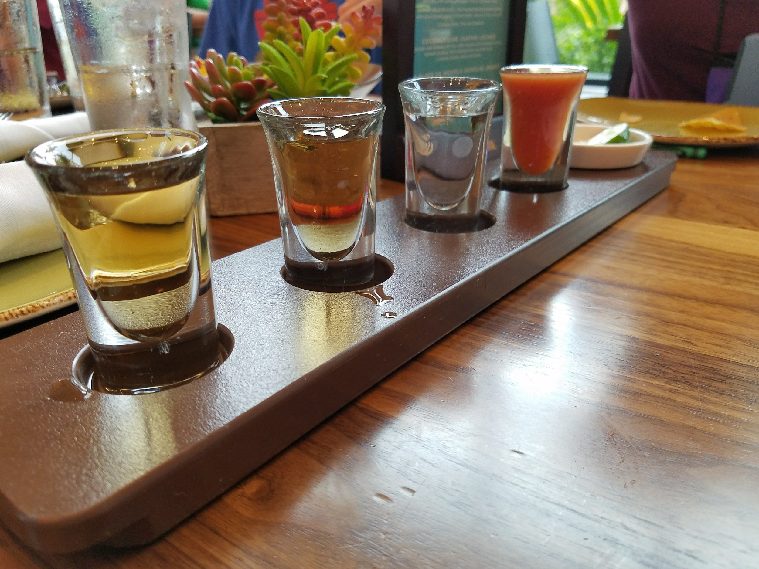 Premium Tequila Flight (L-R):Avión Reserva 44 Extra Añejo, Clase Azul Reposado, Casa Dragones Blanco. Tomato juice, lime, and salt included.