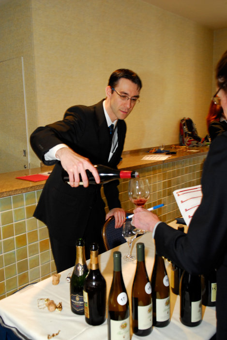 With fewer gray hairs and wrinkles, here I am pouring some killer Italian Pinot Noir at a Vias Imports tasting, ca. 2010.