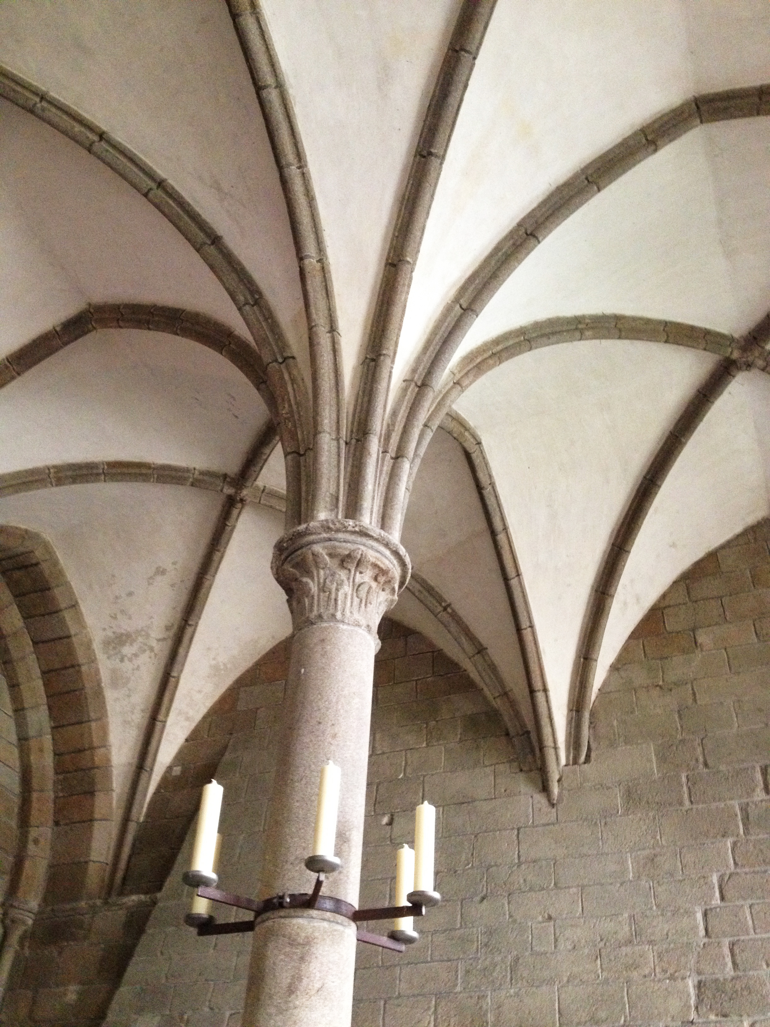 When the front half of the abbey crumbled in a land slide, a new gothic addition was constructed. In the nave of the church, the addition blends seamlessly with the rest of the Romanesque half, but down below, in the more private areas of the building the two styles collide more awkwardly, as seen here.