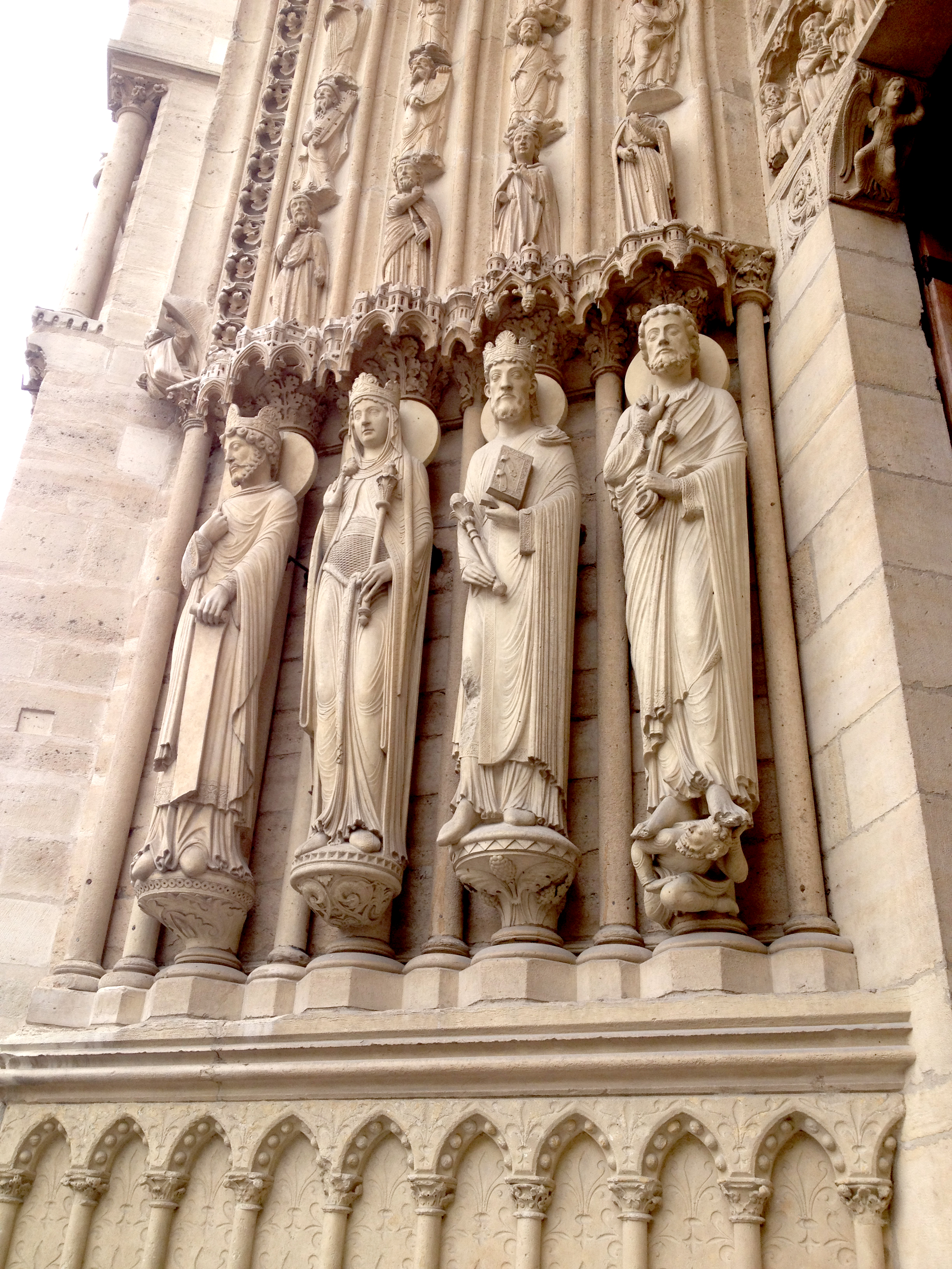 "Some of the beautiful carvings at Notre Dame. As a huge Disney geek, I got the soundtrack of 'hunchback' stuck in my head, and took this photo because it reminded me of one of my favorite lines- ""You never can run from, nor hide what you've done from the eyes of Notre Dame"""