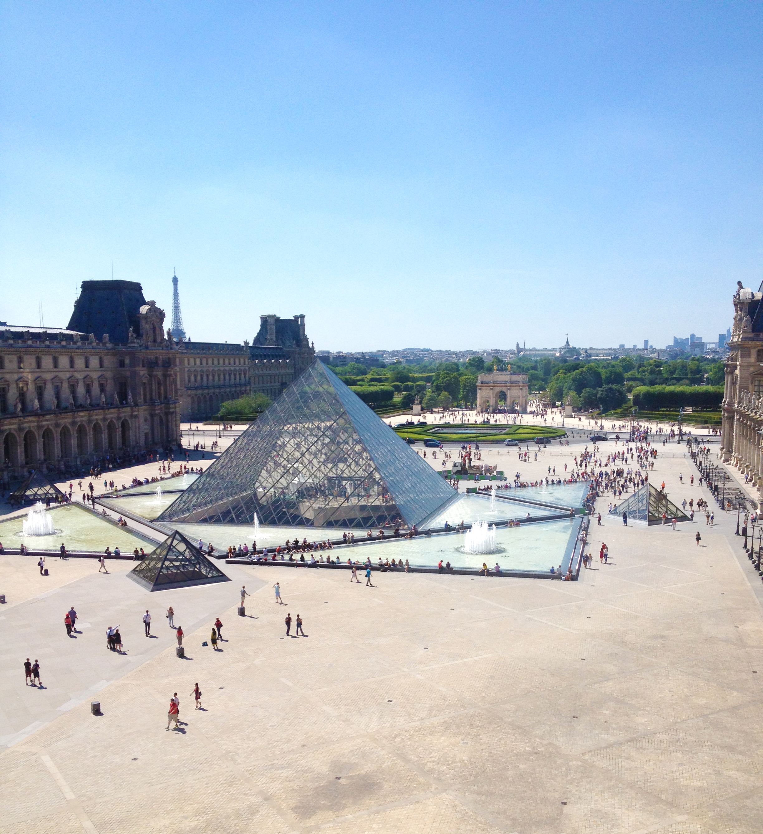 "We stopped by the Louvre to say ""hi"" to Mona, but I was more focused on the views from the building to the courtyard than the art."