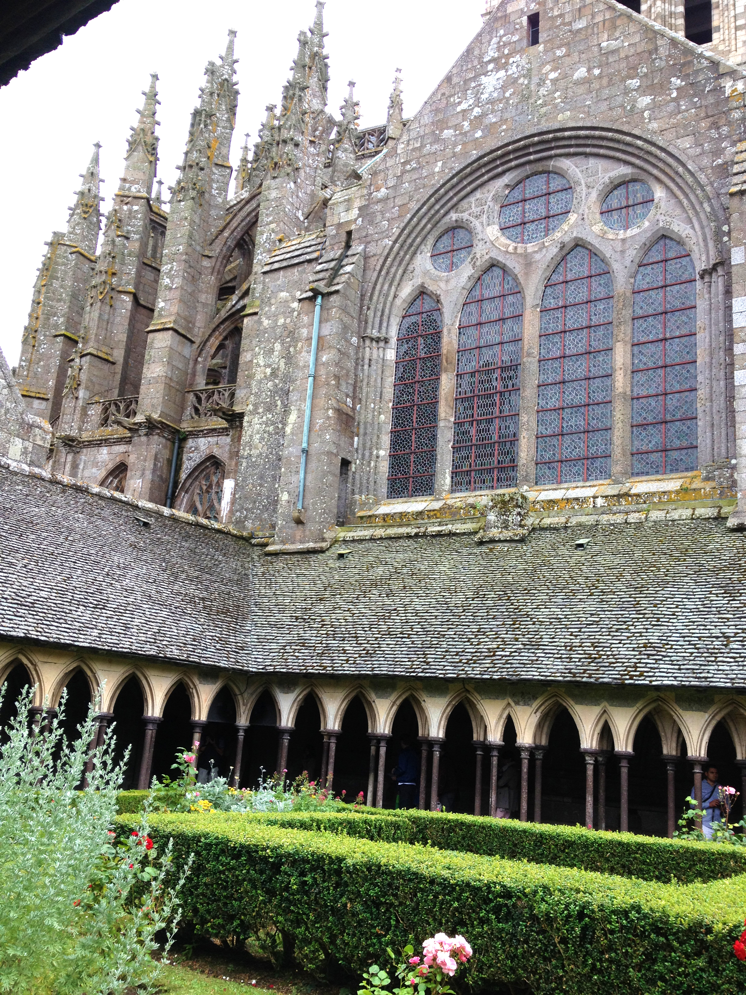 The abbey has a secret roof-top garden framed by gorgeous, crumbling pointed arches.