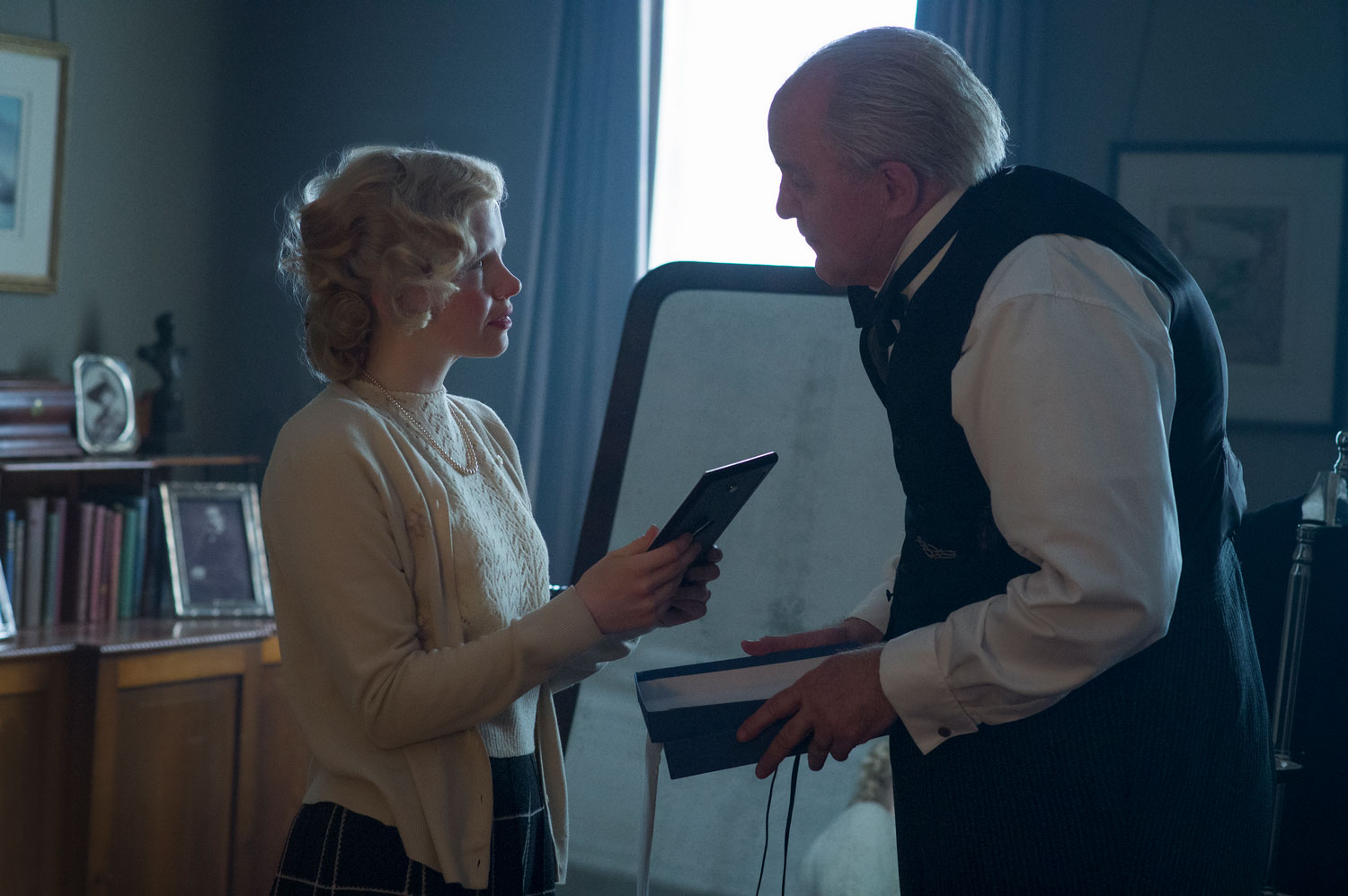 Kate Phillips and John Lithgow in  The Crown . Photo by Alex Bailey for Netflix.
