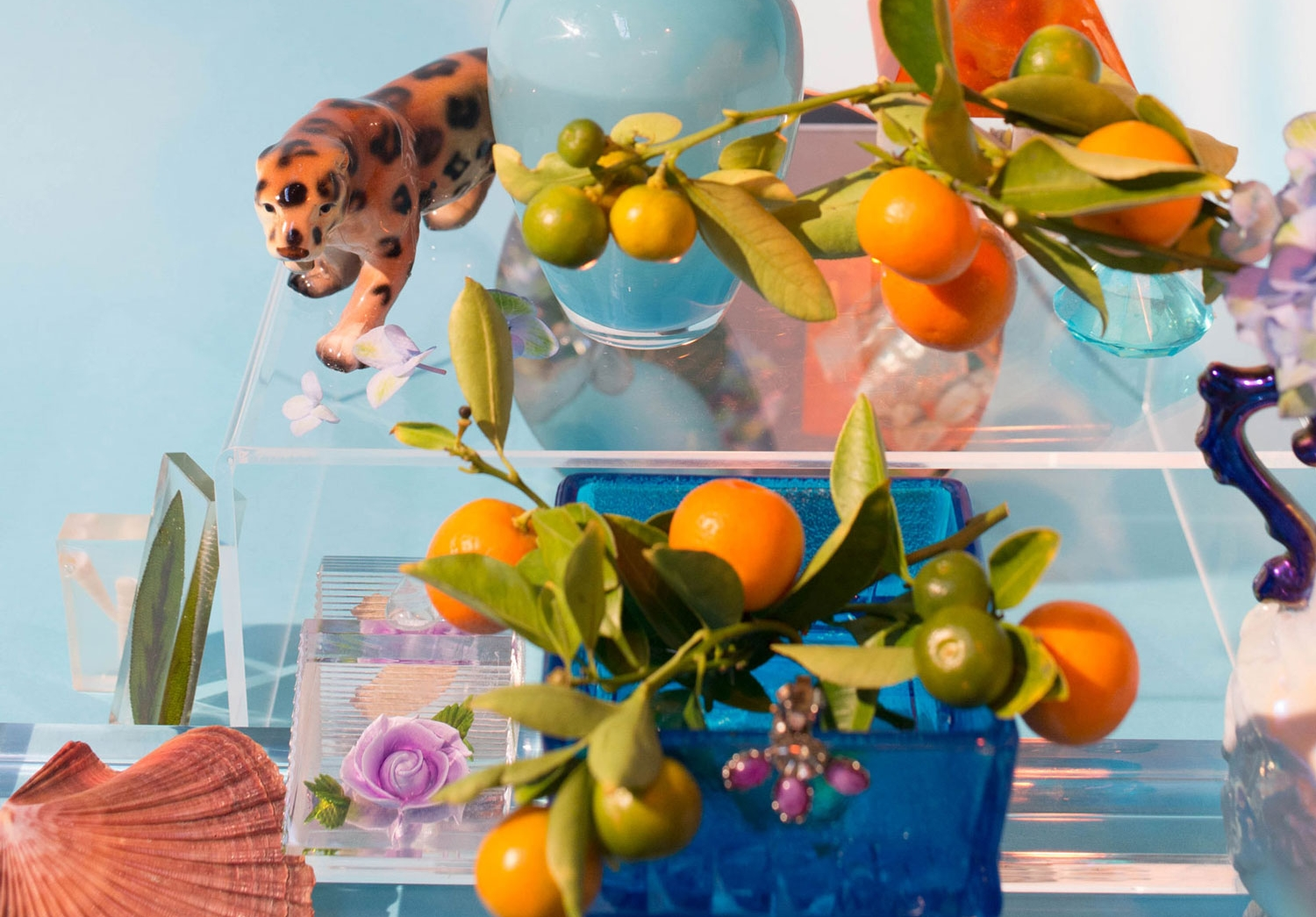 WISH YOU WERE HERE - Using tropical flora, hand-crafted resin pieces, and her personal collection of mid-century Florida memorabilia, designer Rika Mady arranges a series of still lifes inspired by three very different cities in the sunshine state.