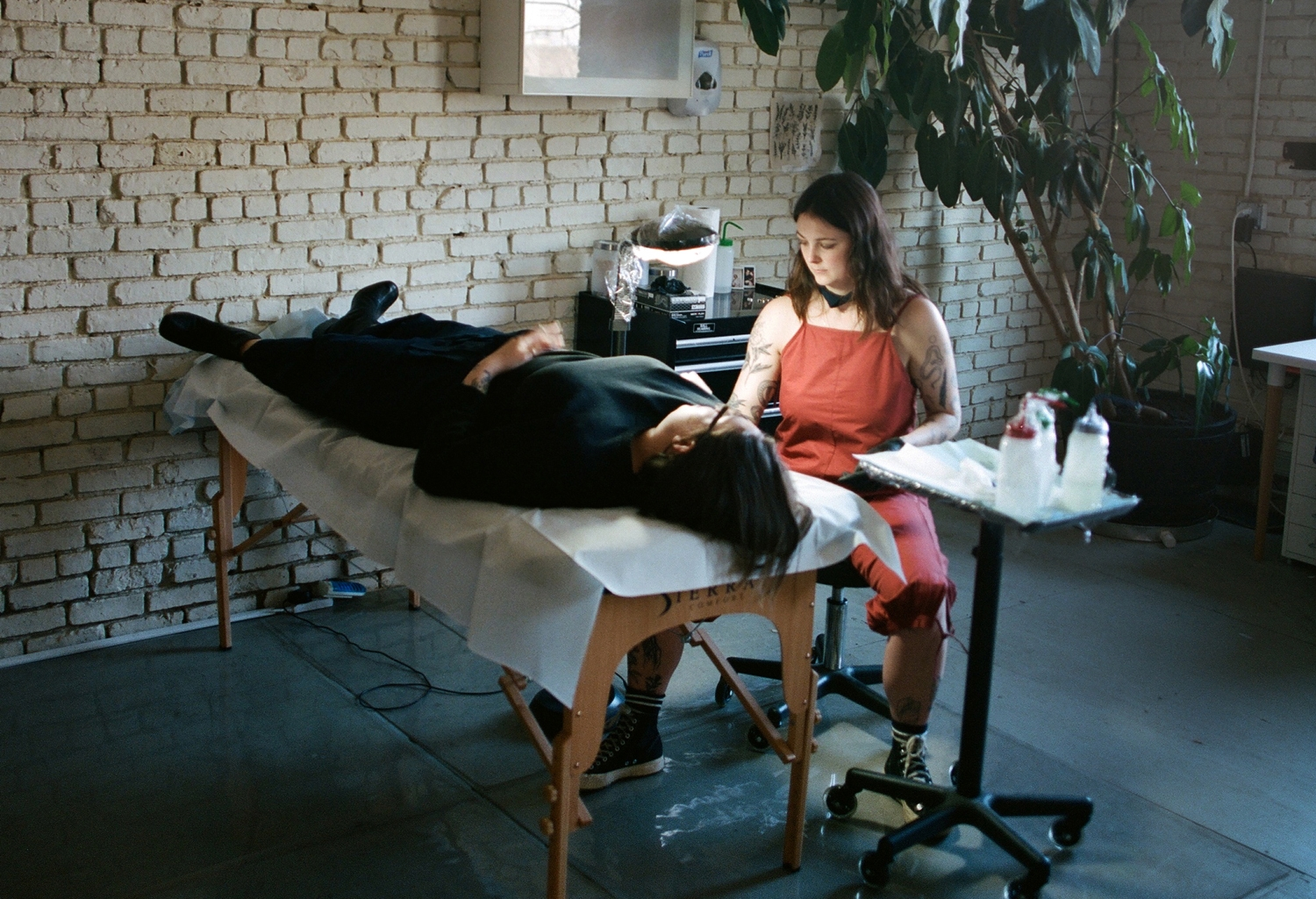 "MEET TEA LEIGH AND KELLI KIKCIO - The Texas and Toronto-raised artists and founders behind Brooklyn-based tattoo studio and community space, Welcome Home, explain why we need more ""radical softness"" in the tattoo industry"