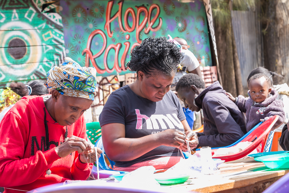 A women's beading collective working for Artisan Fashion in Nairobi, where MIMCO makes bags.