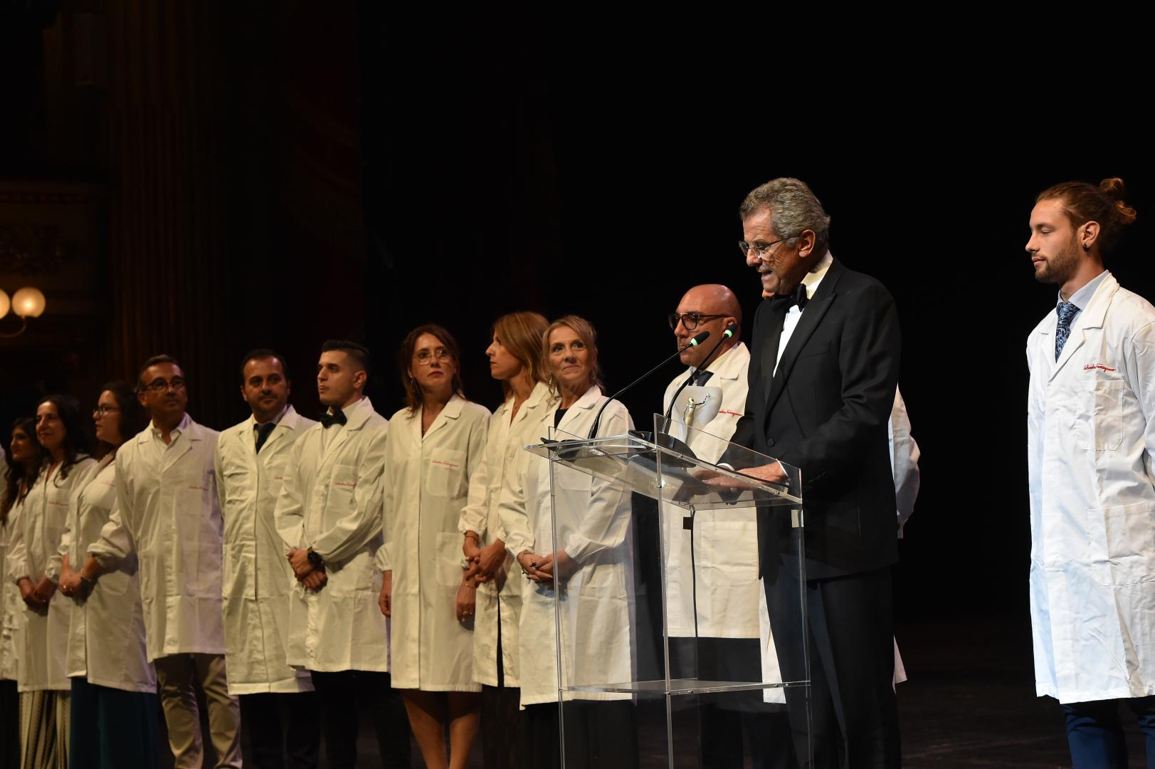 Men and women in white coats - the master cobblers of Ferragamo