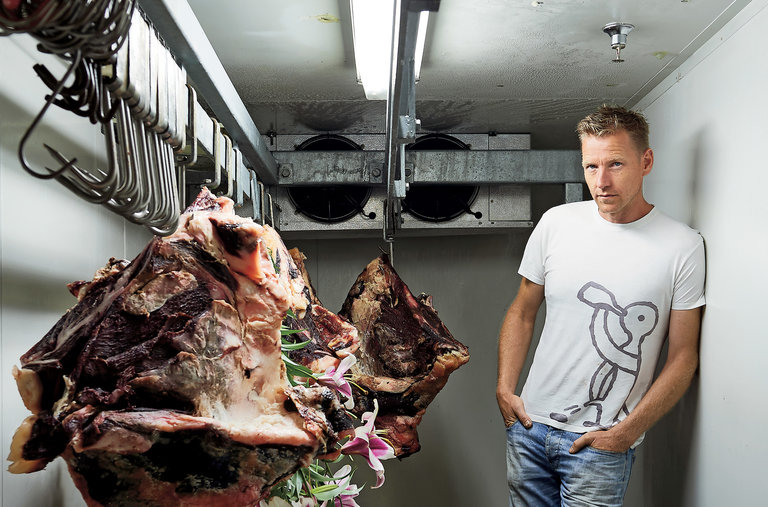 Joost in the meat locker of the Rockpool Bar & Grill, where he has stuffed a beef carcass with stargazer lilies. Photographed by Earl Carter, for New York Times