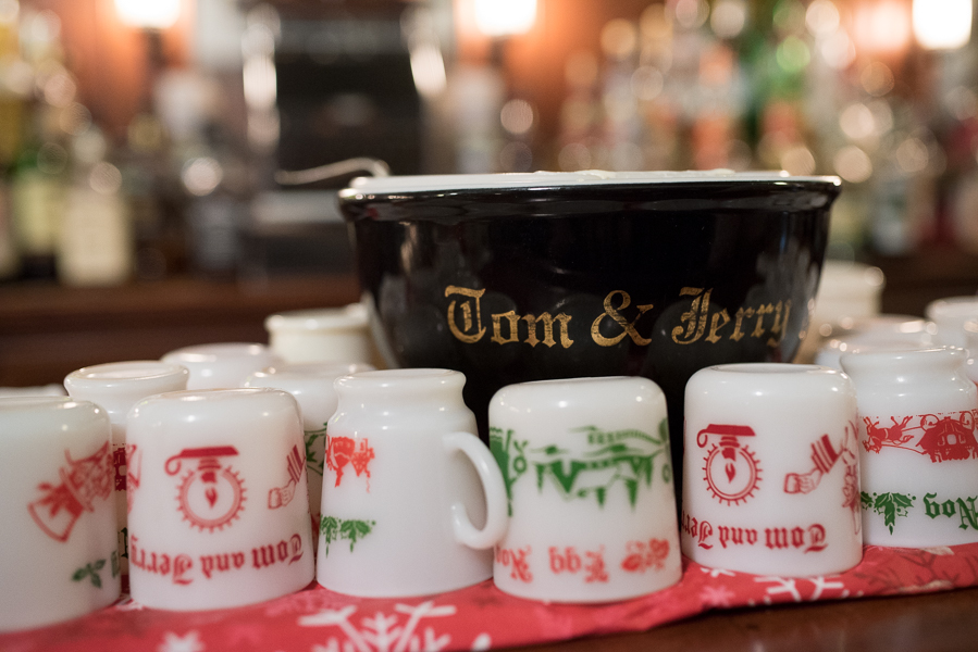 Tom and Jerry bowl and assorted mugs displayed on the bar.