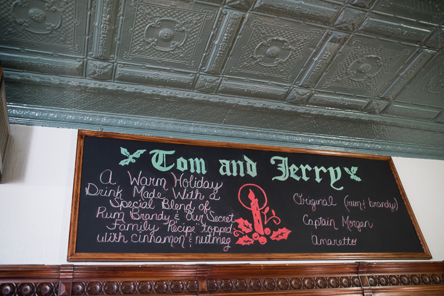 The Tom and Jerry drink menu board! (Note the amazing tin-pressed ceiling!)
