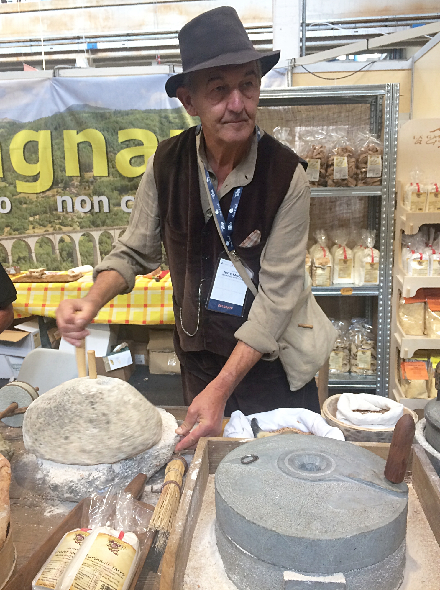 A local farmer from Tuscany demonstrates ancient stone mills. Thank goodness we at The Mill at Janie's Farm have more modern stone-grinding technology!