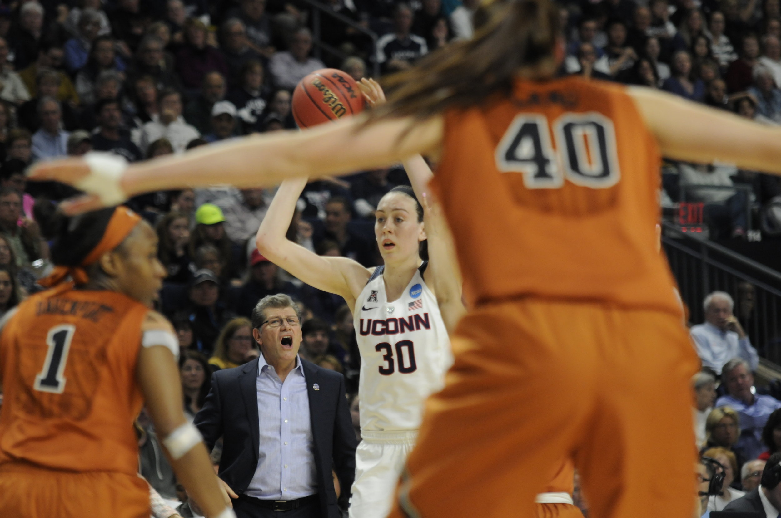 Connecticut forward Breanna Stewart (30) looks to pass the ball as head coach Geno Aurimemma calls out directions during an NCAA tournament quarterfinal game against Texas on March 28, 2016.Stewart finished with 21 points, 13 rebounds,5 assists, 3 blocks, and 3 steals in UConn's 86-65 win.