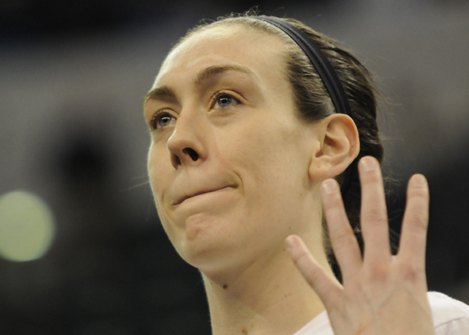 Breanna Stewart holds up four fingers, representative of her four national championships following UConn's 82-51 victory over Syracuse at Bankers Life Fieldhouse in Indianapolis, Ind. on Tuesday April 5, 2016. Stewart was named the Most Outstanding Player of the Final Four for the fourth straight year. No player has ever done that before.