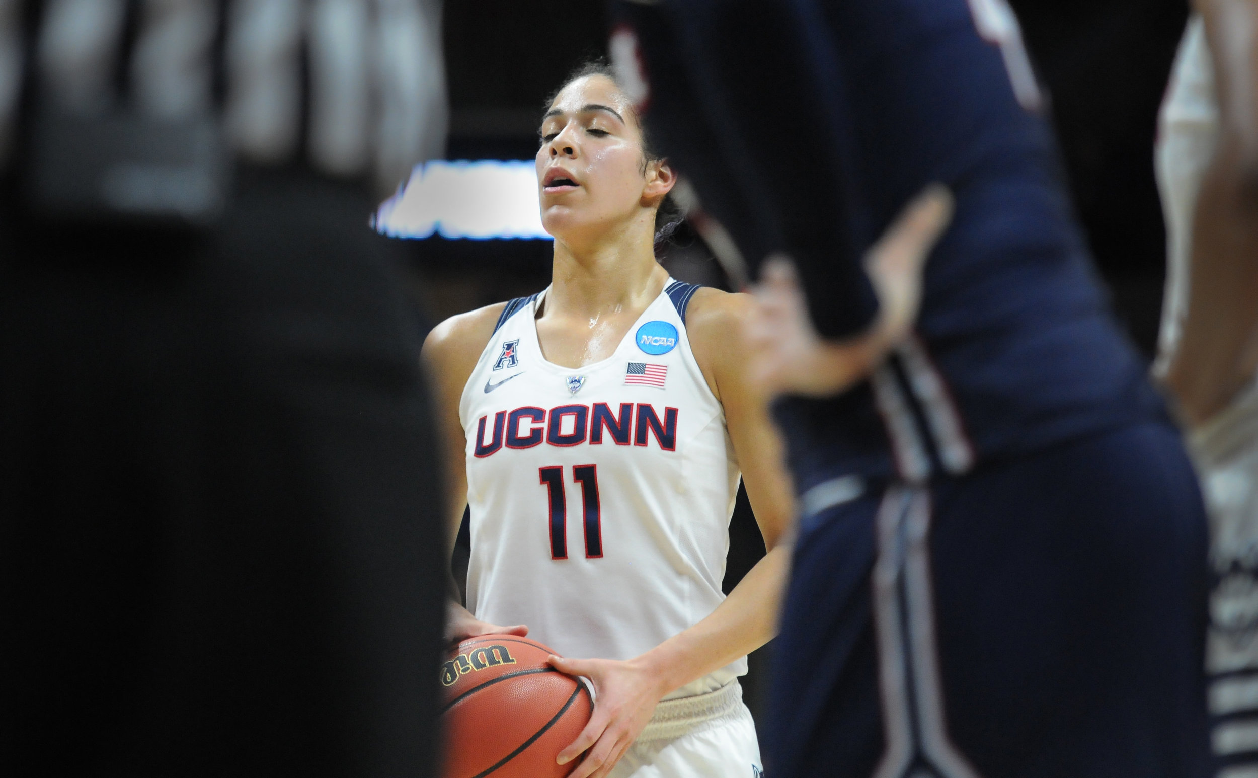 Sophomore guard Kia Nurse (11) prepares for a free throw against Duquesne in the second round of the NCAA tournament on Monday, March 22 at Gampel Pavilion. She scored seven points with three rebounds en route to a 97-51 victory.