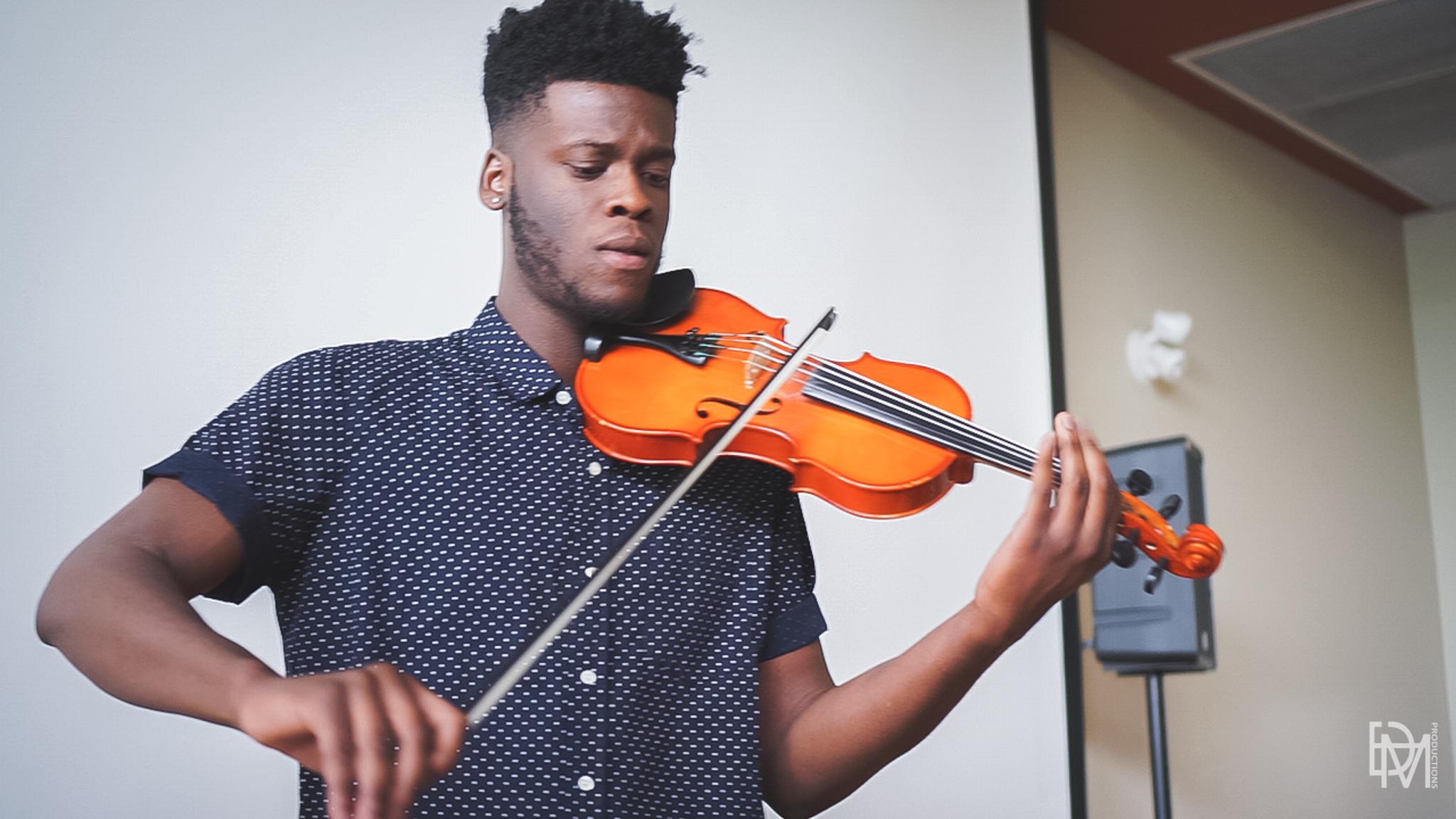 Violinist Osaretin, performing