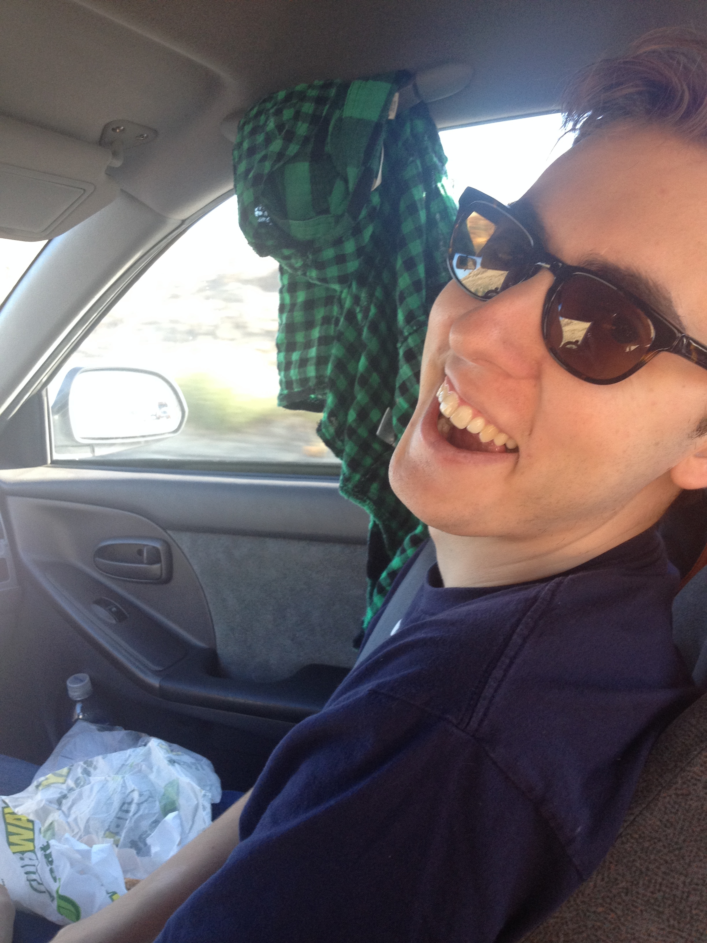 Colin enjoying the trip (and subway sandwich apparently)