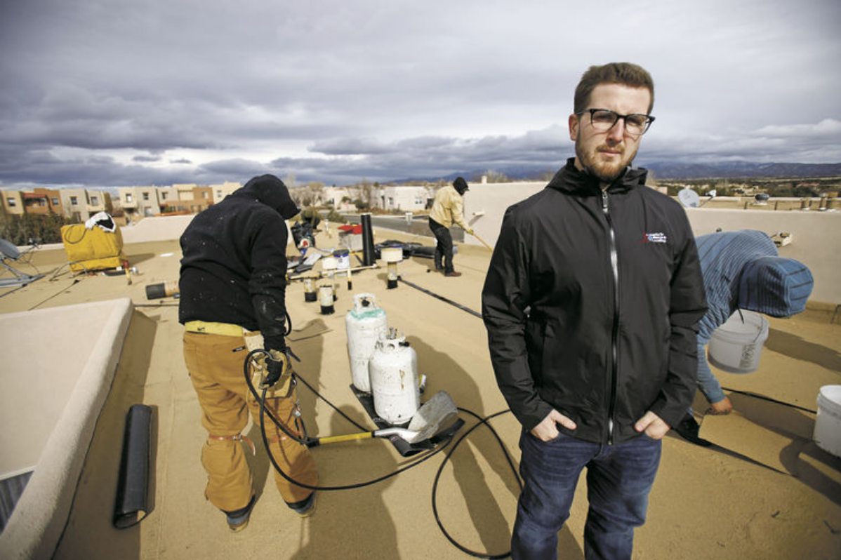 Francis McPartlon, 24, owner of Santa Fe Stucco & Roofing, poses for a portrait at a job site in Santa Fe on Friday, January 19, 2017. The young man took over small roofing company from his dad and has turned it into $6 million operation -- one of biggest roofing companies in state. Luis Sánchez Saturno/The New Mexican