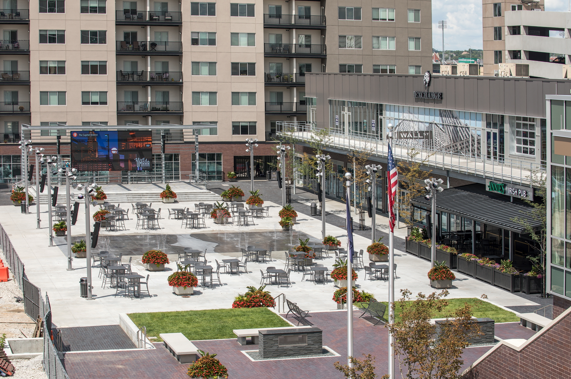 The Capitol District,  opened in 2017,   occupies a key site for the future of Downtown Omaha, connecting the Old Market to the events district and linking the Riverfront to the downtown business district. The plaza contains 90,000 sq. feet of retail and restaurant space, 20,000 sq. feet of office use, and a direct connection to the 333 room, full-service Omaha Marriott Downtown. It's the urban spot where fun-seekers can live, eat and drink in one community—all within walking distance of Omaha's best civic, cultural and entertainment venues. The football field sized plaza also consists of a 60 ft stage, and an outdoor video screen making this a perfect intimate venue for personal sporting events.