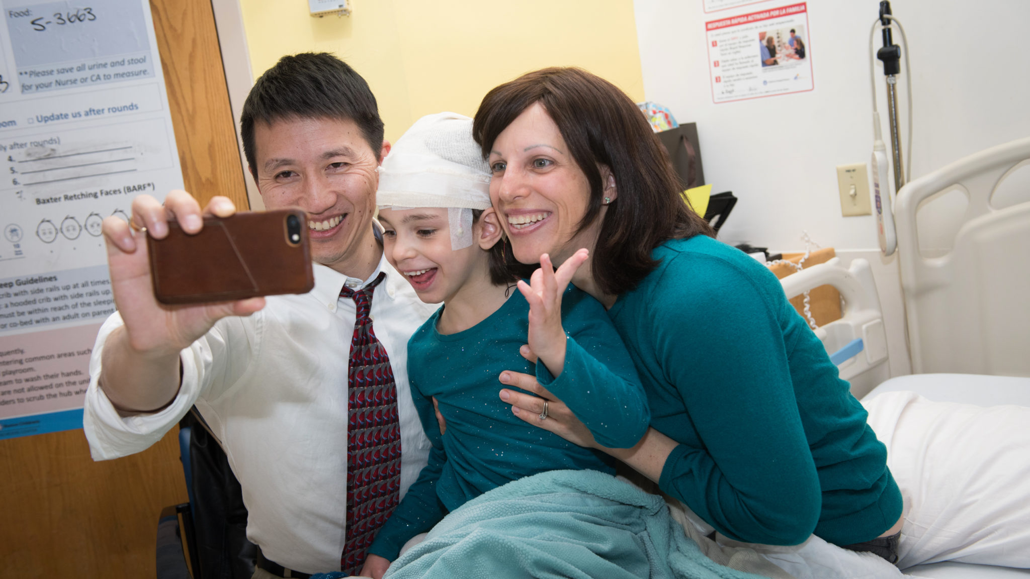 Dr. Yu + Julia + Mila on the first day of Mila's treatment .jpg