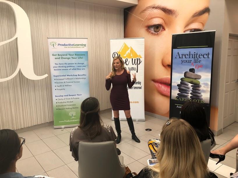 Karen delivering an inspiring talk at Rise Up!
