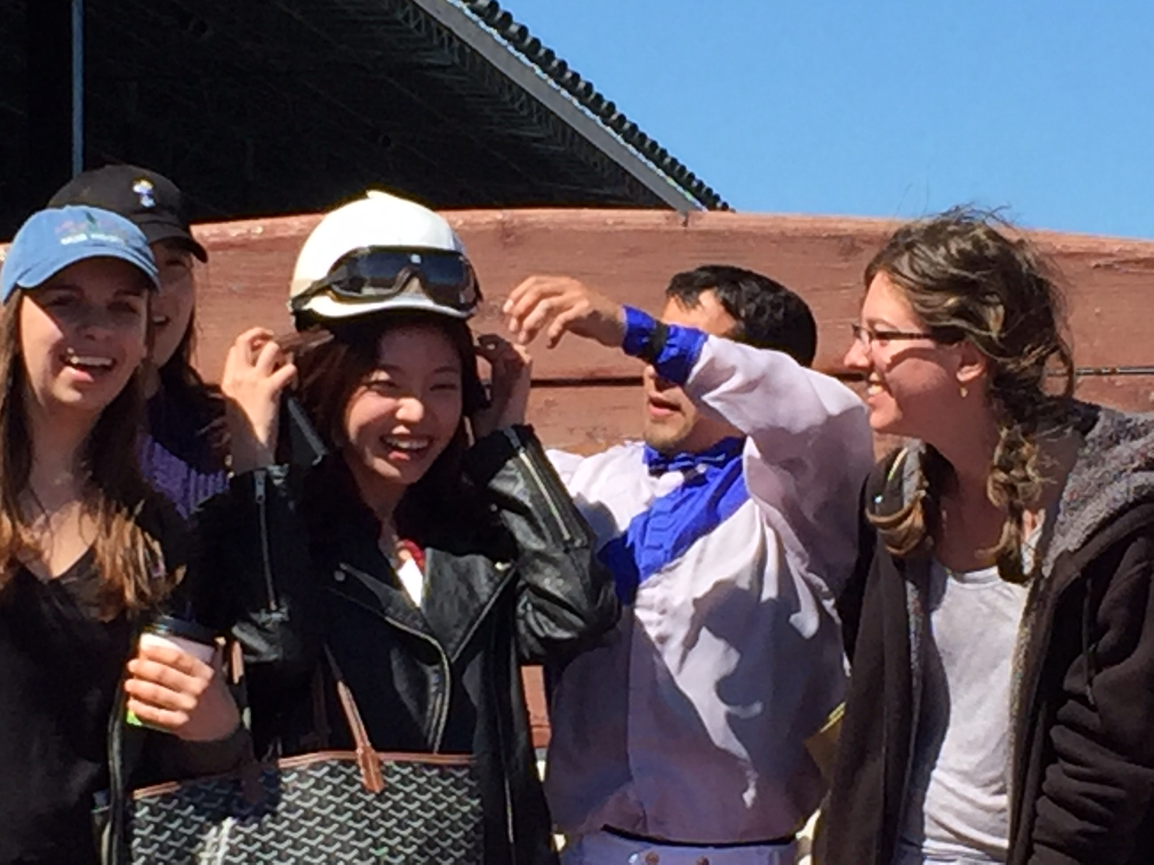 Sue making friends with a horse jockey!