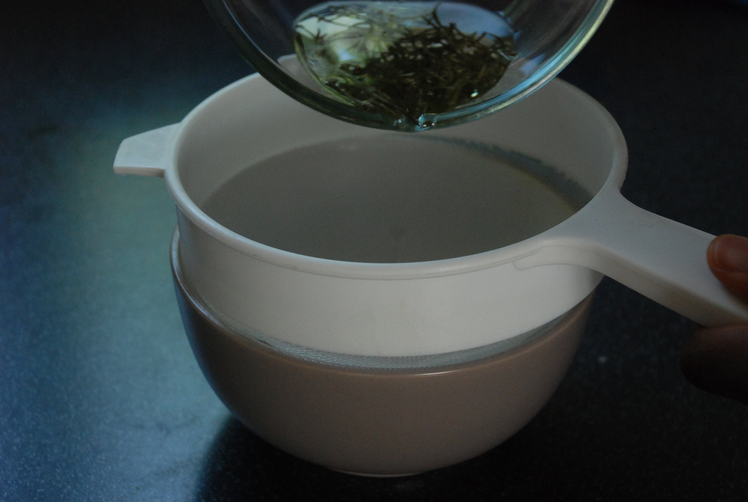 Strain the herbs using a mesh strainer or cheese cloth