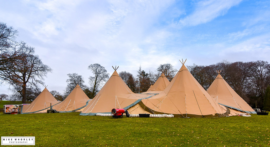 Outdoor-shot-of-the-tipis-with-the-vans.jpg
