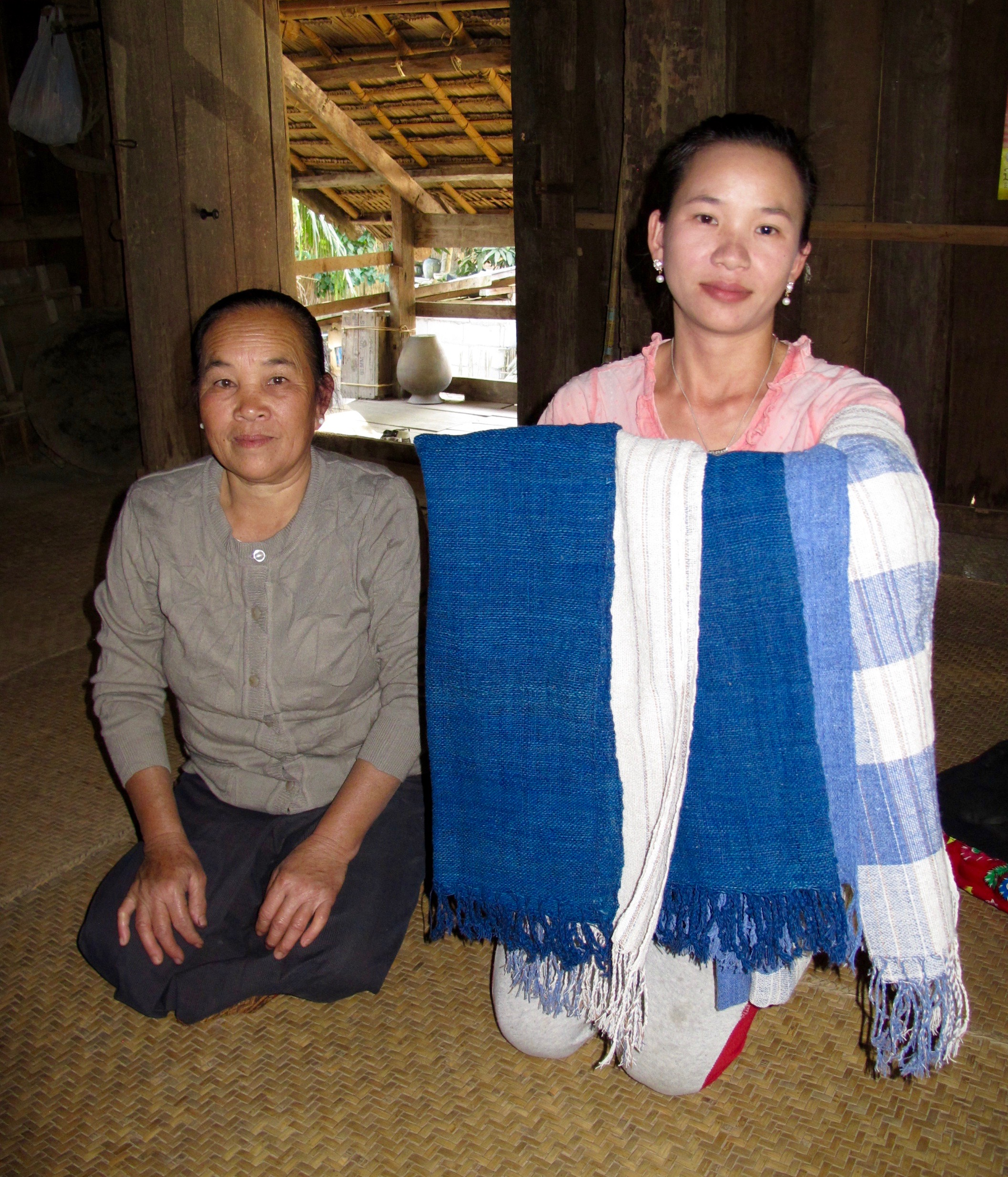 Chaban and her daughter Noy with their rich indigo scarves