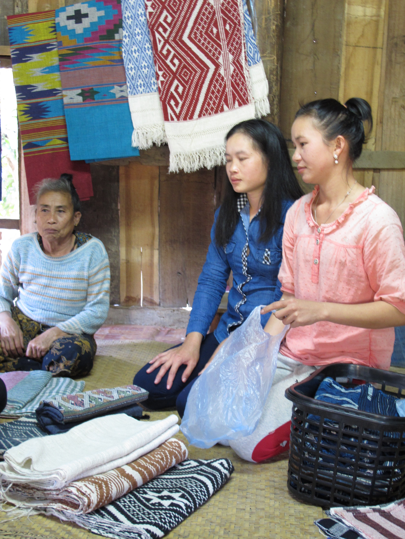 A beautiful display of Tai Leu style designs by village weavers