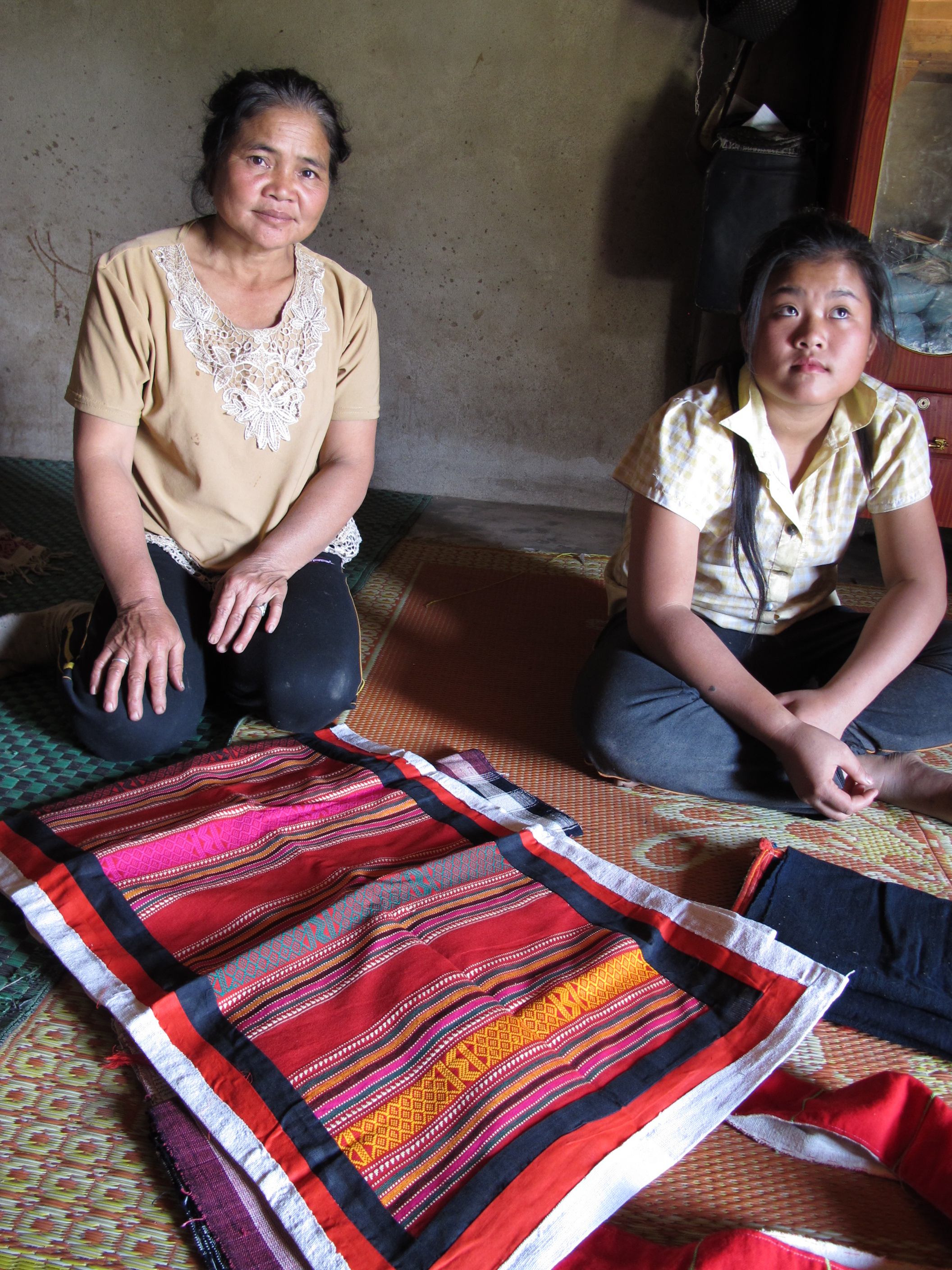 Sin's mother, Lasoy showing us her traditional handwoven textiles
