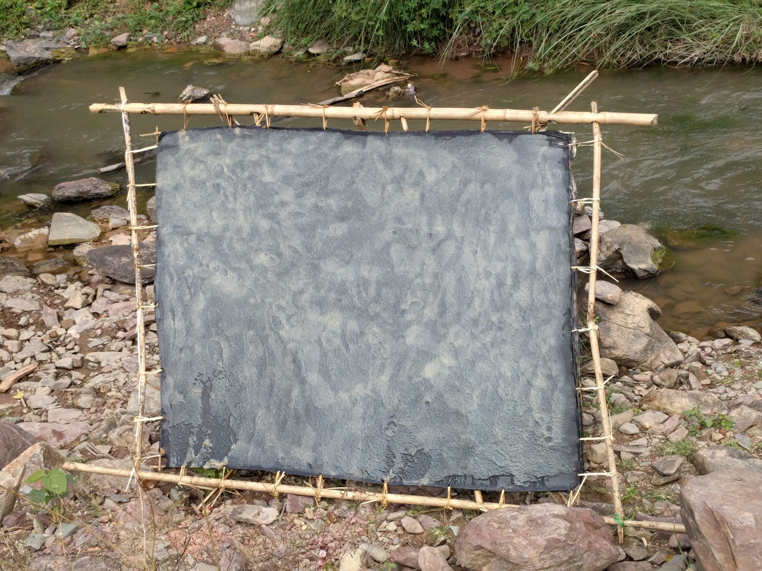 Drying handmade bamboo paper dyed with indigo