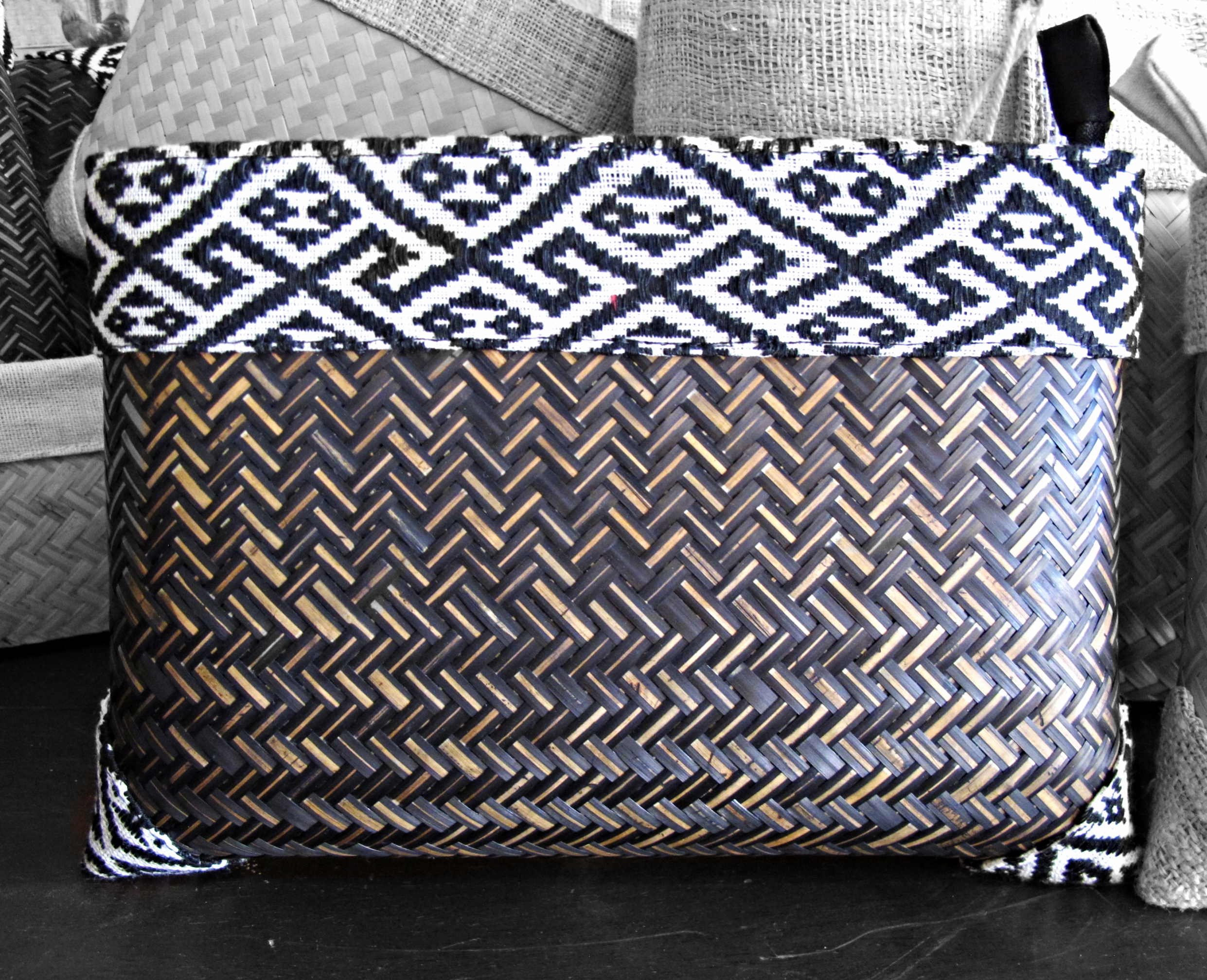 [Fishbone bamboo weave and I wonder how it was made with alternating light dark. Following the weave of the hemp patterned trim and my curiosity wanders, wondering whose artisan hands crafted this, her name and about her life. Bamboo clutch handcrafted by women of the Tai Lao ethnic group, Phonsong Village. Curated by  Ma Te Sai .]