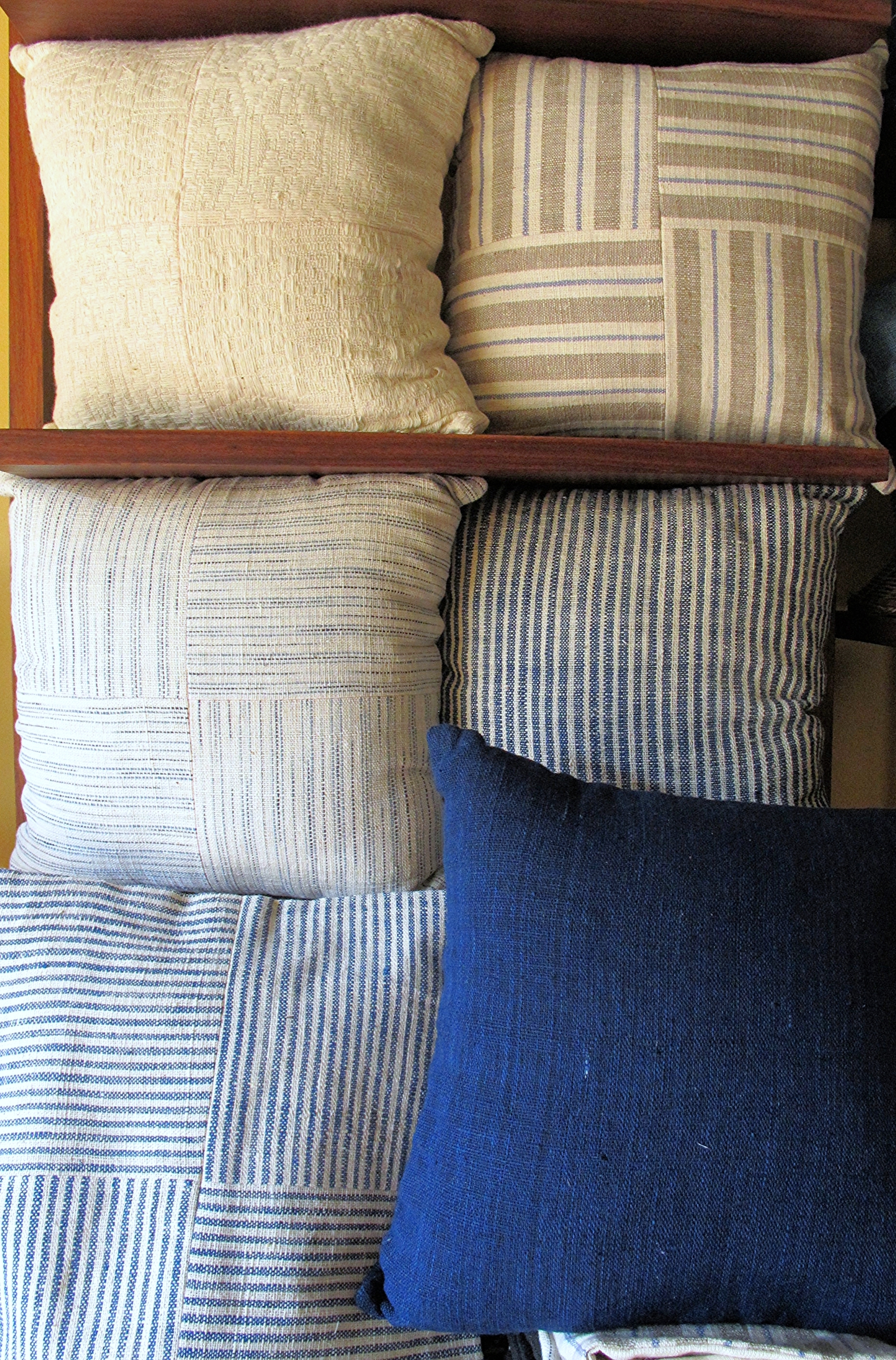 [Natural colors in peach yellow and indigo blue, in easy even stripes, cozy and soft squeezed together. Dreamy cushion covers handwoven by women of the Tai Leu ethnic group in Banayan village Laos. Also curated by  Ma Te Sai .