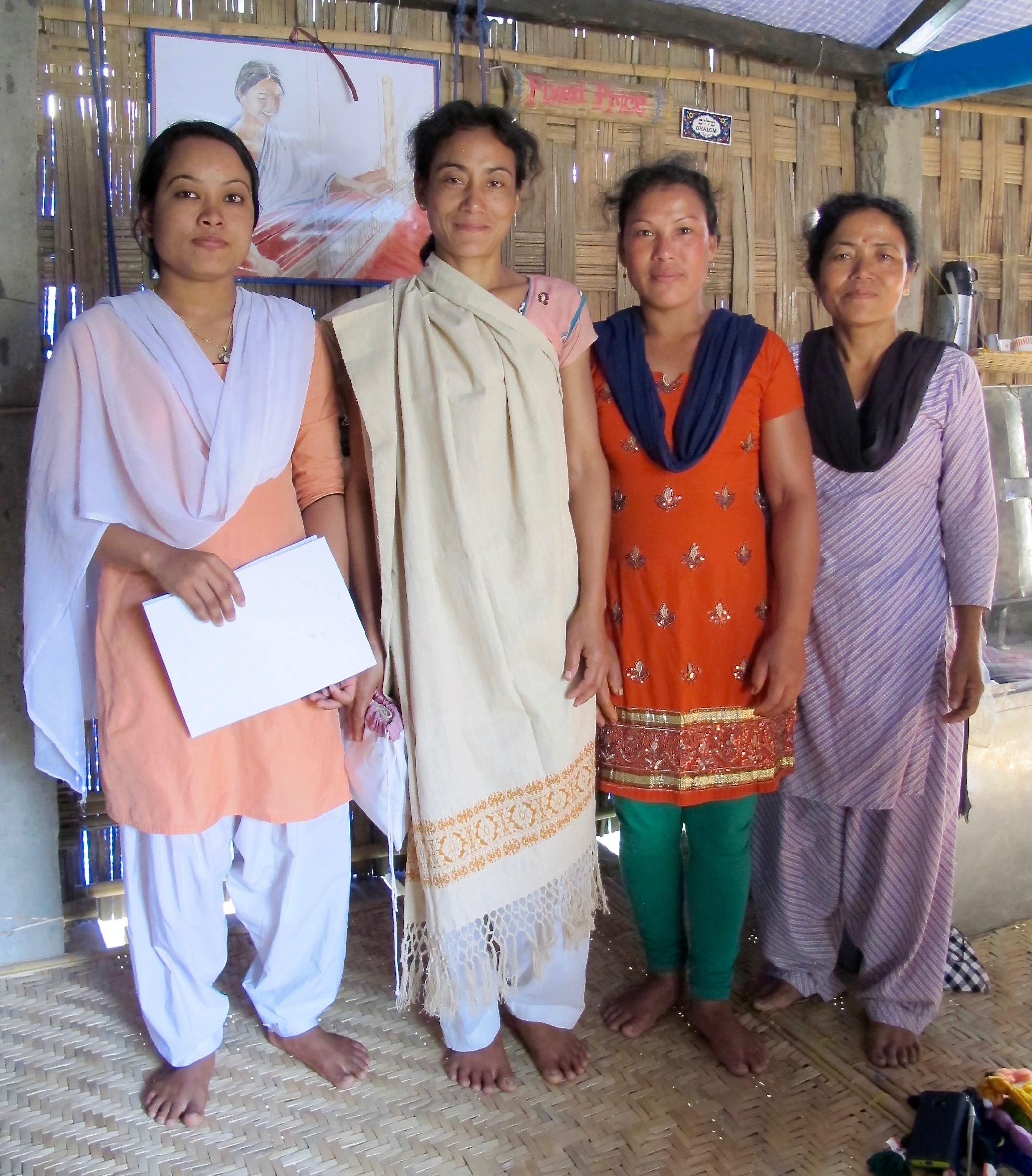 Not only has the artisan cooperative become a source of skills training and income for the women, it has provided a platform for emerging women leaders and collective action. Weaver Jan Moni, second from left, draping the handwoven and hand dyed stole she made from Assamese Eri raw silk.