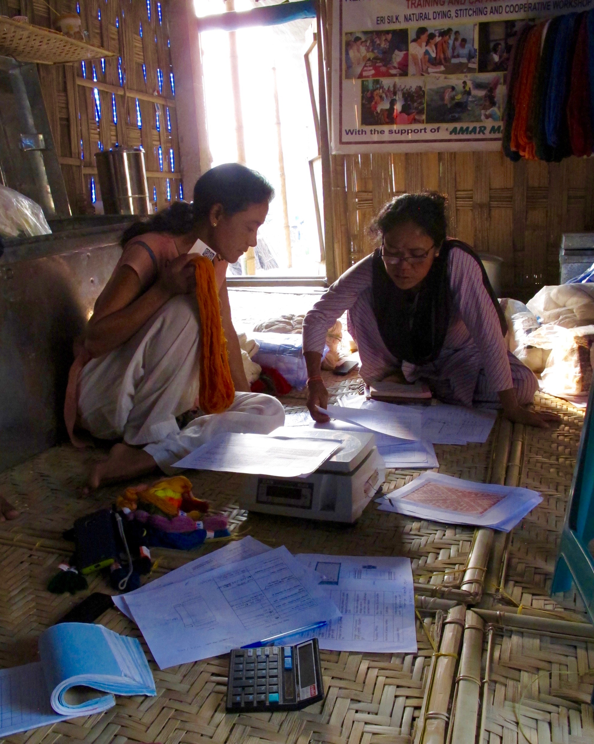 Women weavers and leaders from Rengam, an artisan cooperative in Majuli Island, Assam, India, which has supported over 80 women affected by floods and erosion by harnessing the unique weaving traditions of the Mising ethnic group.