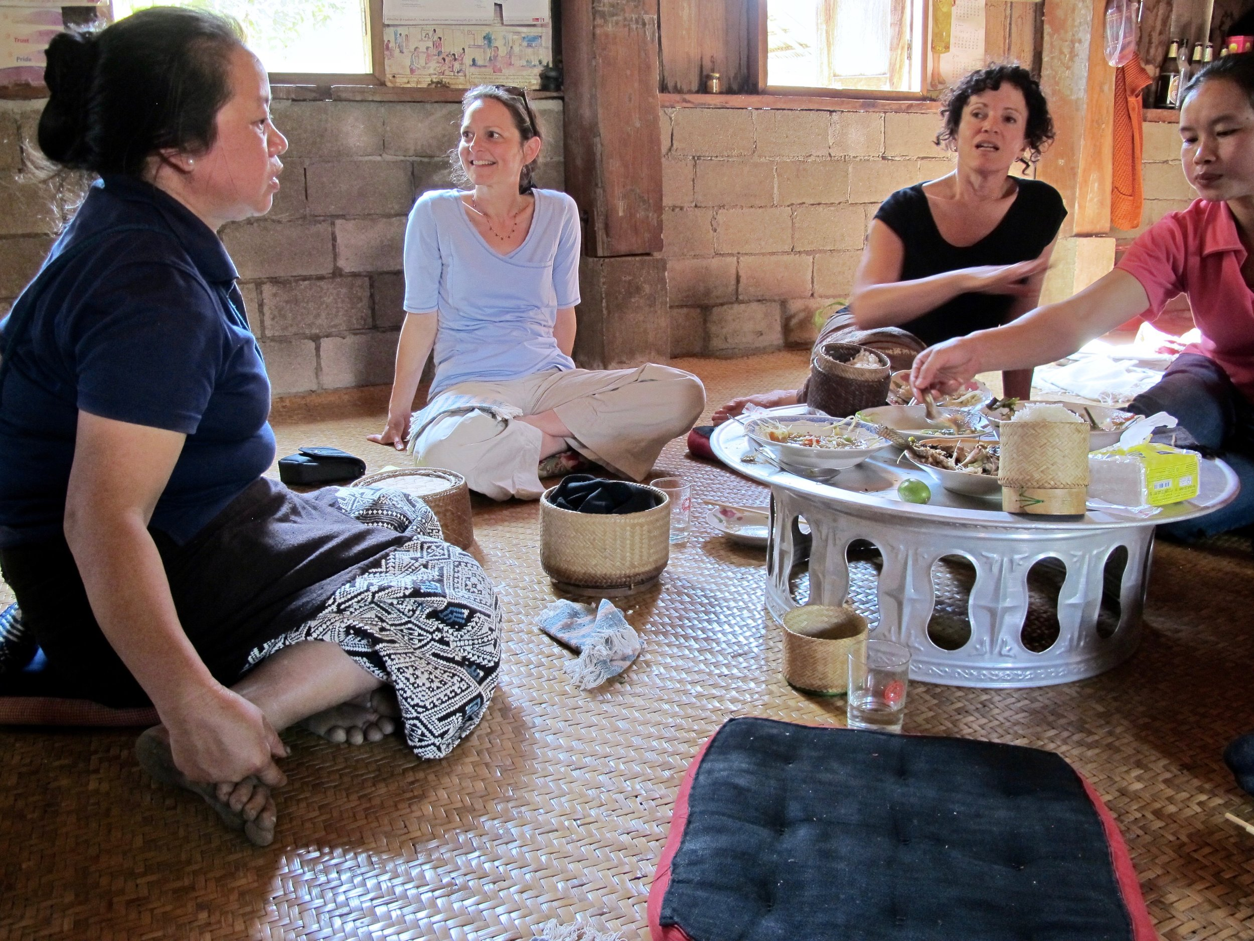 Feasting on traditional Laos cuisine for lunch that was prepared by some of the village women. Mae Sam is seated left, a master dyer; then me enjoying every moment of it; then Emi Weir of the artisan enterprise Ma Té Sai; and Sengmany, who has become a natural leader among the weavers.