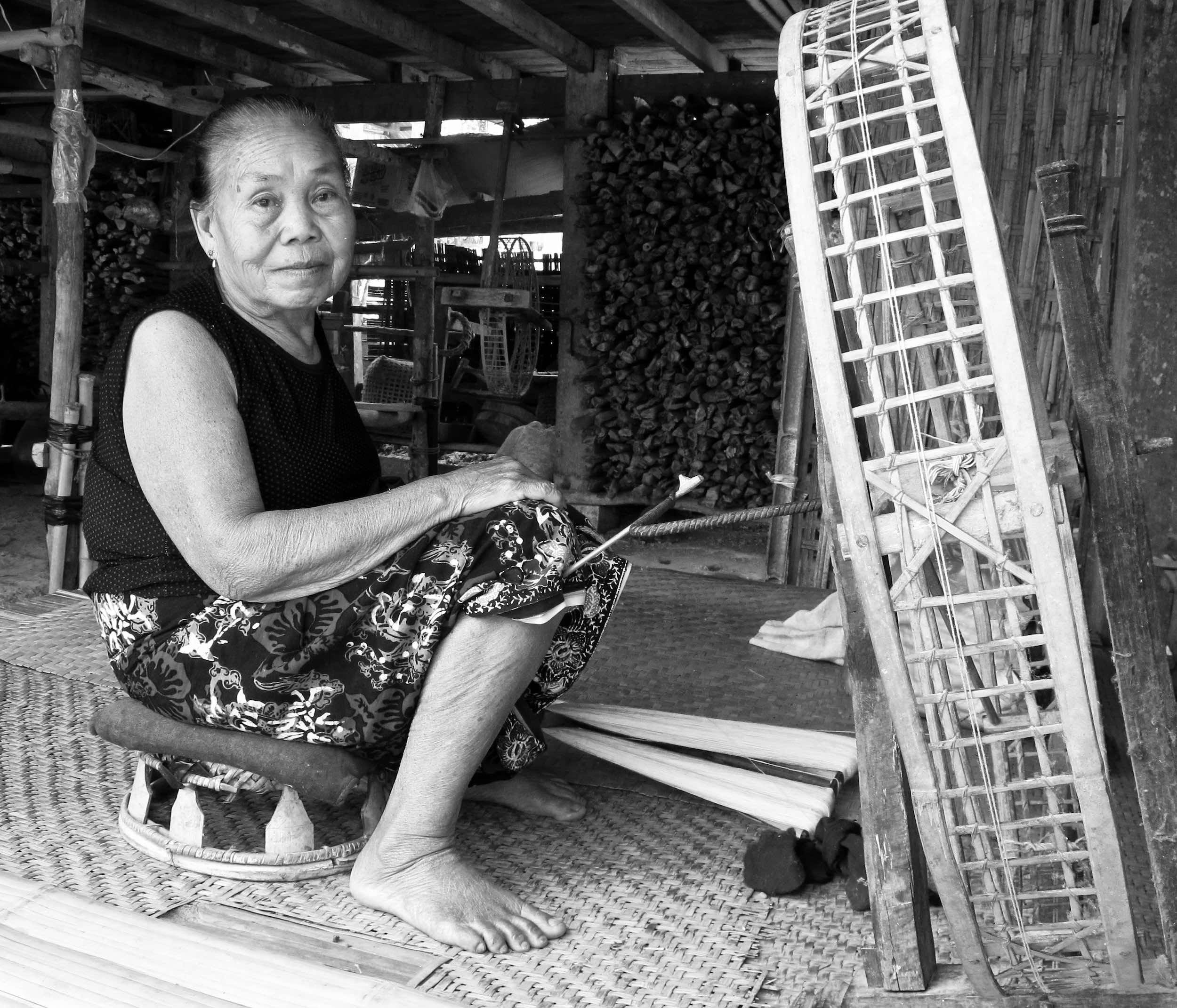 Walking around the Tai Lue village of Nayang Tai we met En, one of the many weavers there, who showed us spinning cotton into thread for weaving. Read more in our blog here:  A Chance to Go Back to a Tai Lue Weaving Village