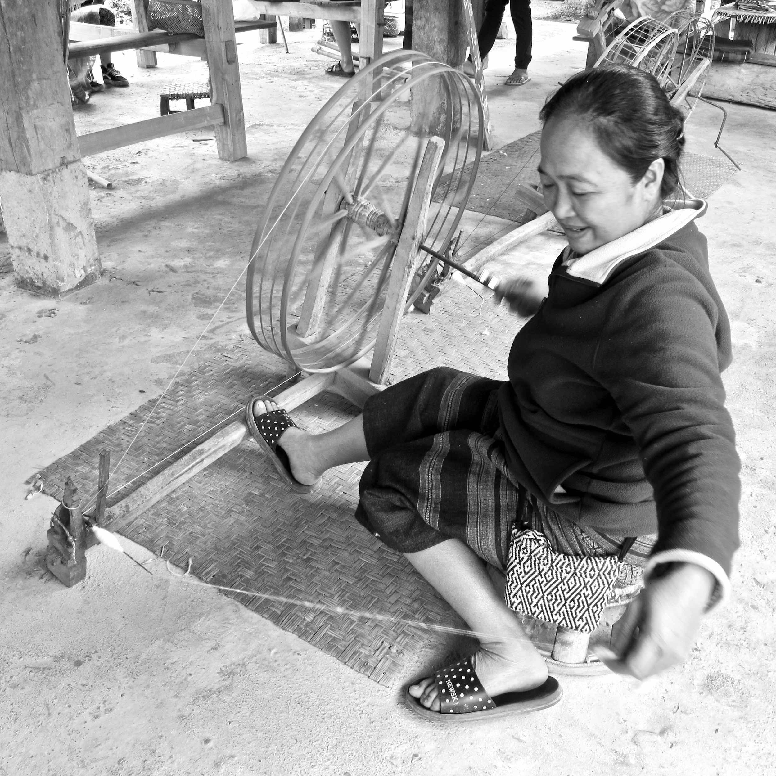 Master weaver, Sang, spinning cotton into thread in the village of Nayang Nua at the Ban Lue Handcrafts & Homestay, is the weaver of the Tai Lue Earthy Cotton Large Wrap - Double Weave. To read more about Sang and the Ban Lue Handcrafts & Homestay, read our blog   A Creative Oasis in Northern Laos .
