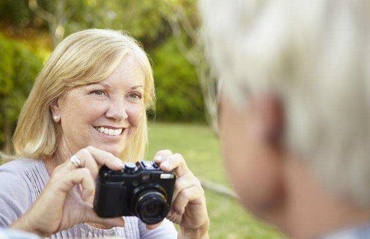 Older-woman-taking-photo.jpg