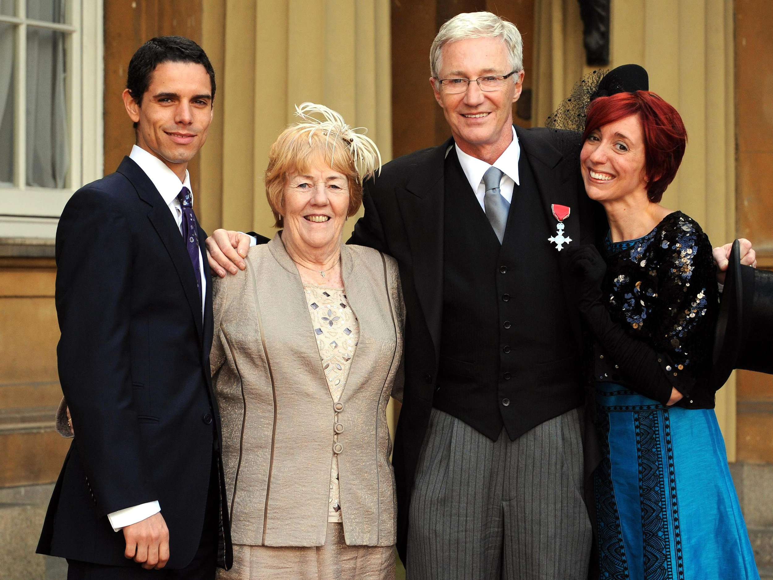 Paul's partner, sister and daughter join him to collect his MBE