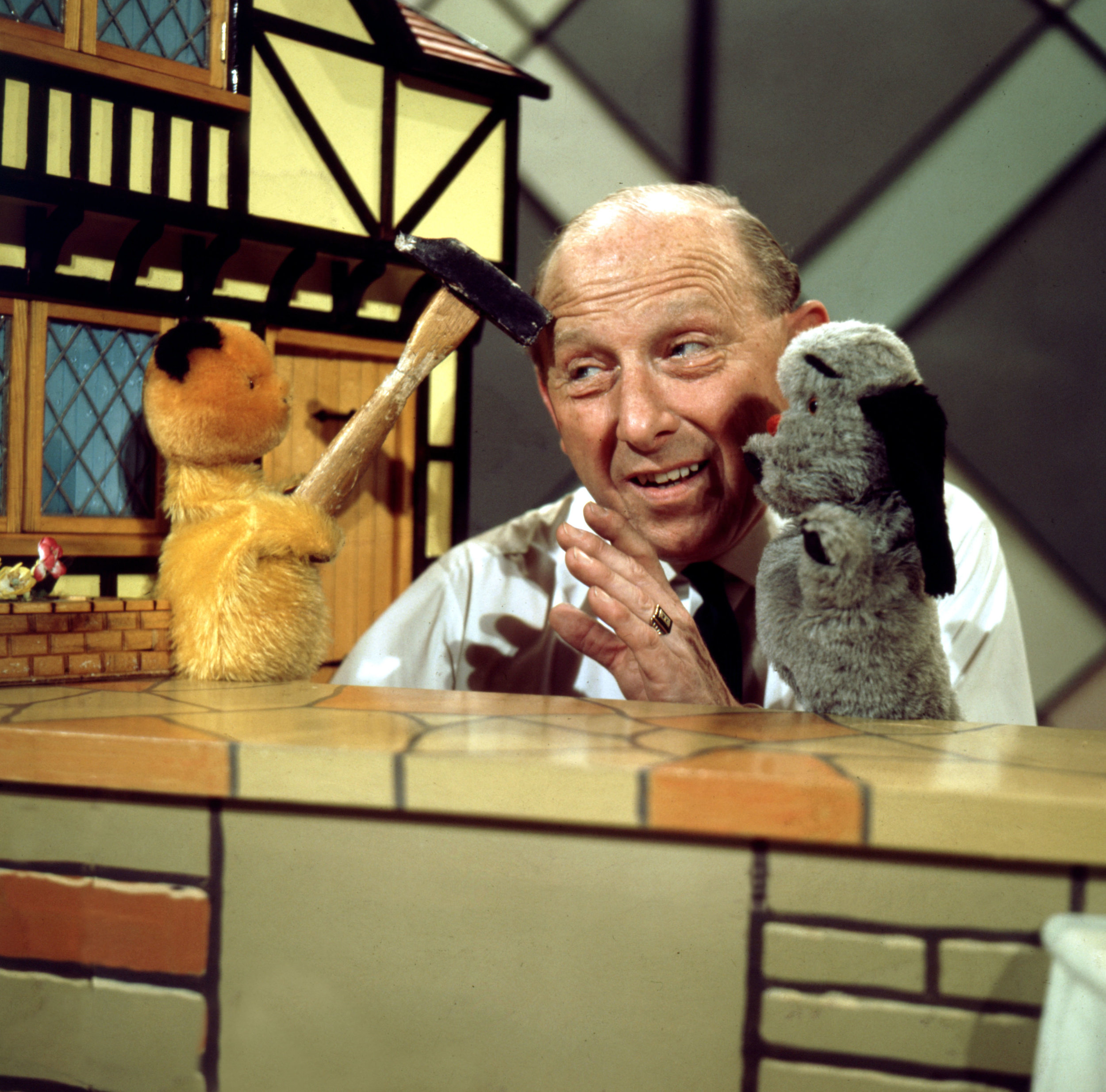 Harry Corbett with his beloved Sooty and Sweep