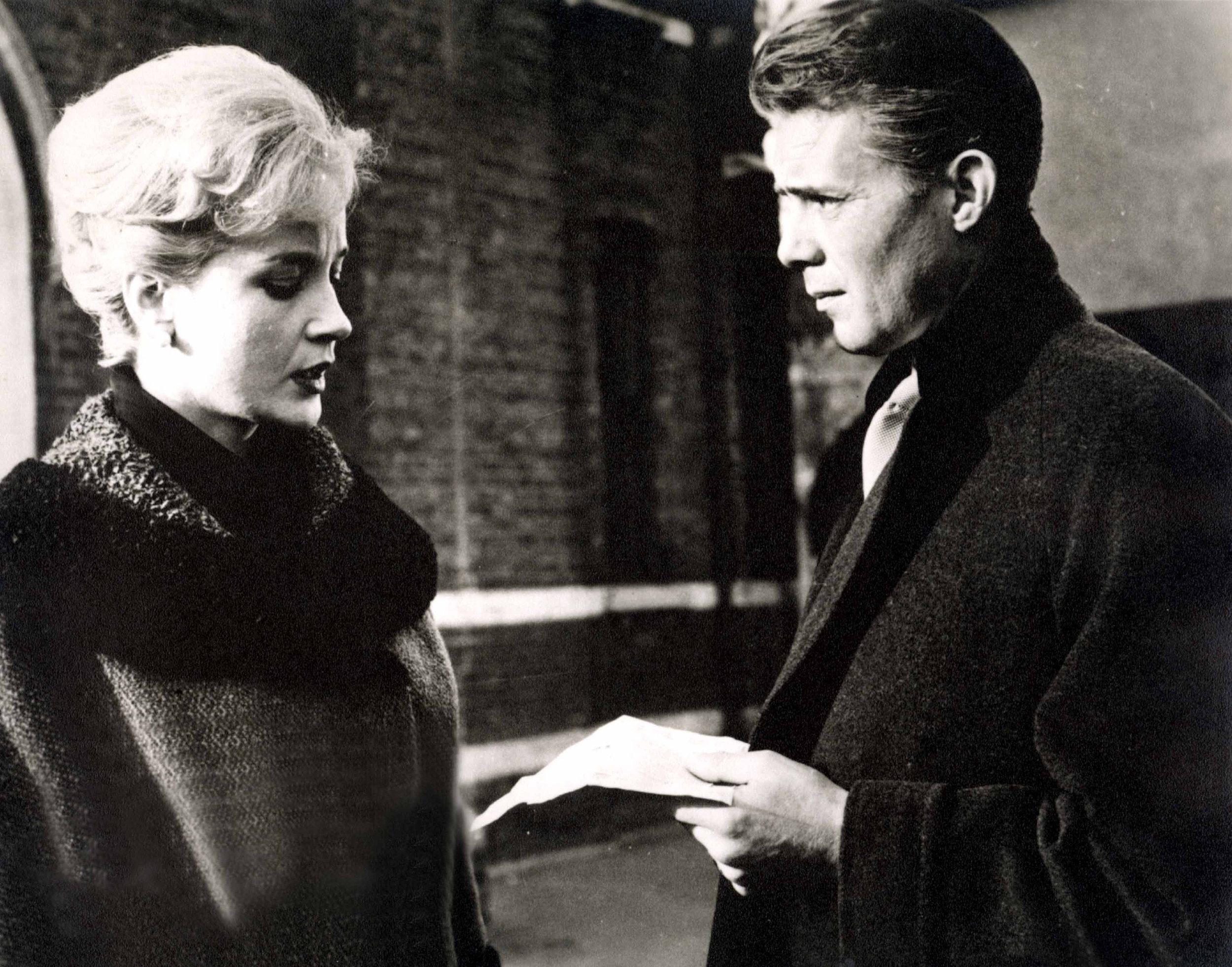 Dick in Victim (1961) alongside Sylvia Sims