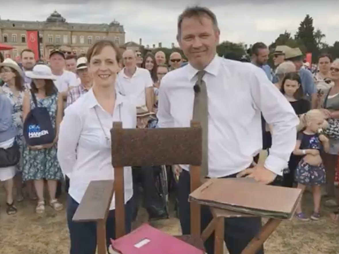 Claire and John with the famous chair, script and photo album. Credit: USCelebrity (YouTube)